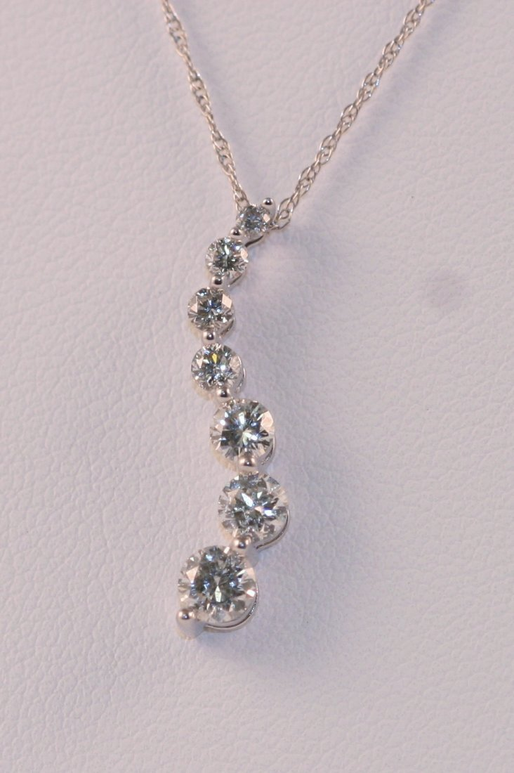 14K W/G DIAMOND NECKLACE.