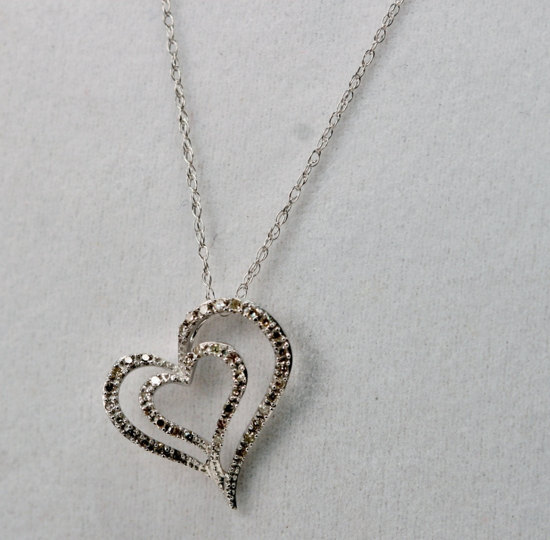 14K W/G DIAMOND HEART NECKLACE.