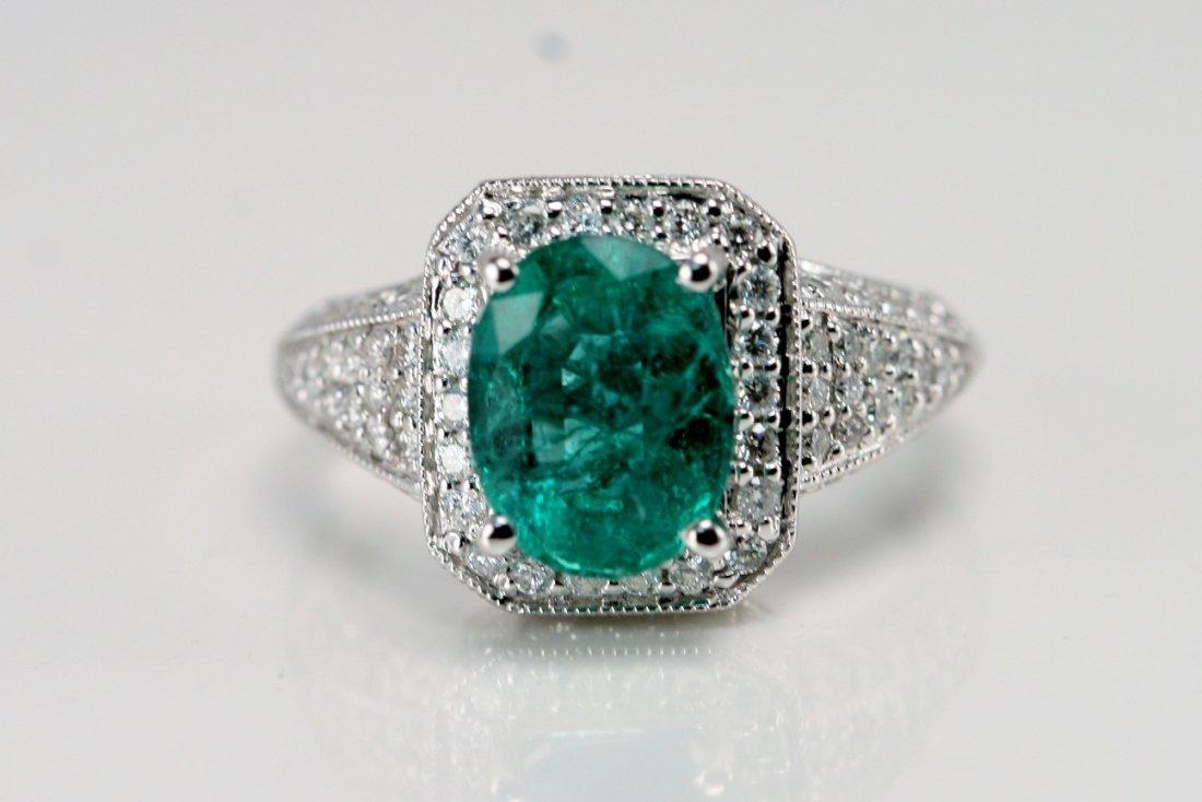 18K W/G DIAMOND AND EMERALD RING