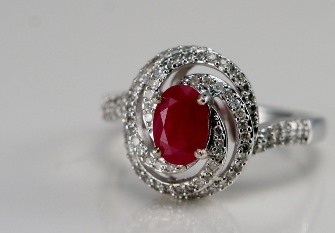 14K W/G RING WITH DIAMONDS AND RUBY.