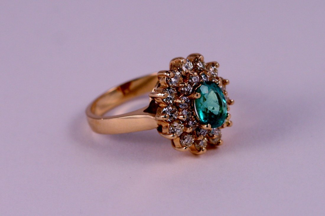 14K Y/G DIAMOND AND EMERALD RING