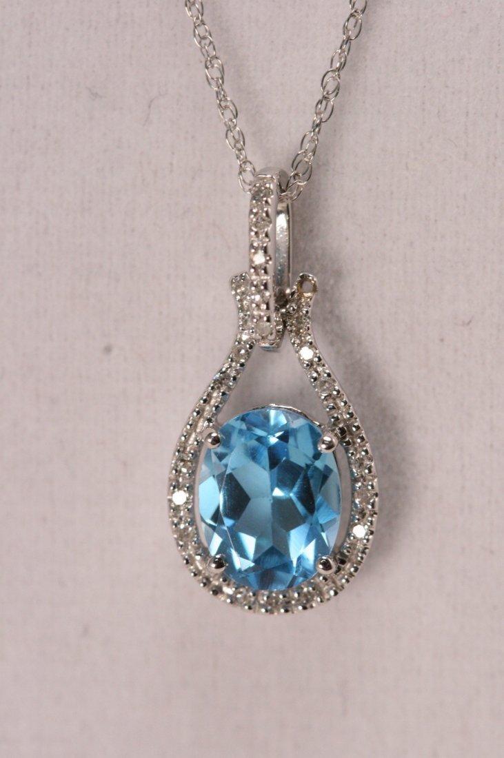 14K W/G DIAMOND & BLUE TOPAZ NECKLACE.