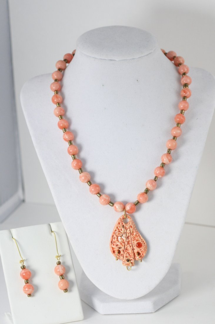 HAND MADE ceramic coral colored beaded necklace and
