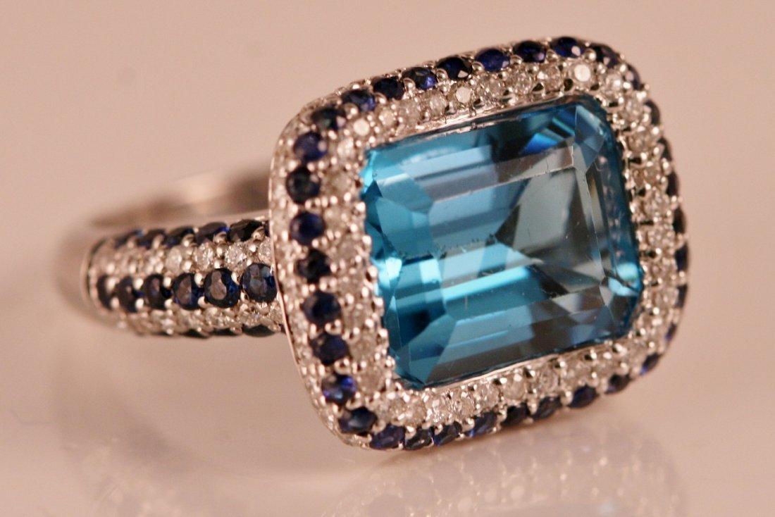 14K W/G RING W/ DIAMONDS, SAPPPHIRES & BLUE TOPAZ.