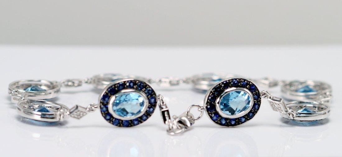 14K W/G DIAMOND, SAPPHIRE AND BLUE TOPAZ BRAC