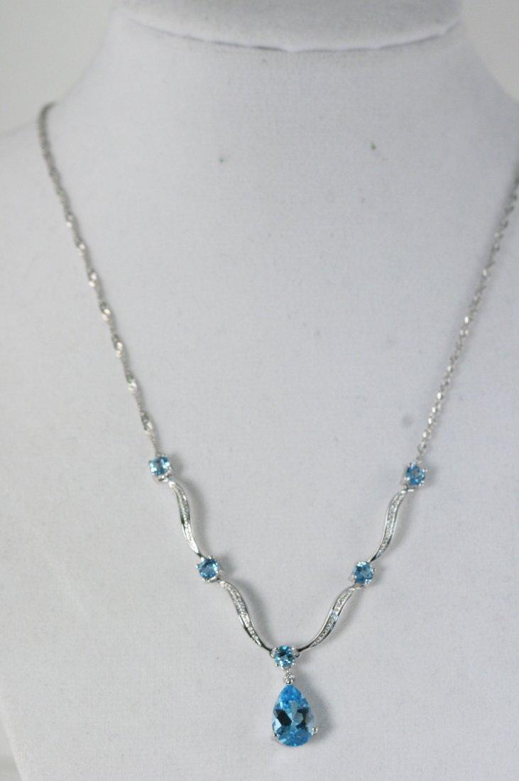W/G DIAMOND AND BLUE TOPAZ NECKLACE