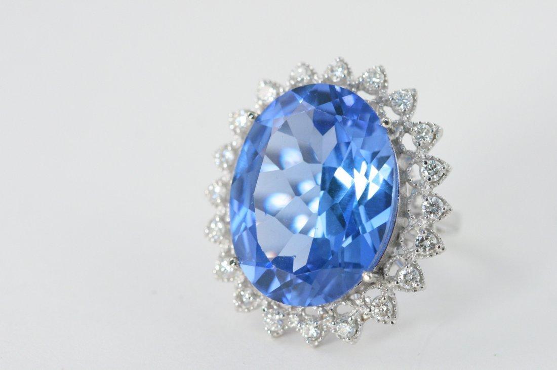 14K W/G DIAMOND AND BLUE TOPAZ RING