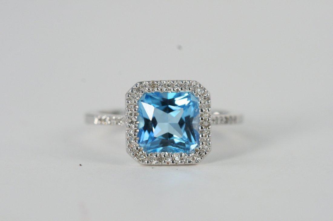 14K W/G BLUE TOPAZ AND DIAMOND RING