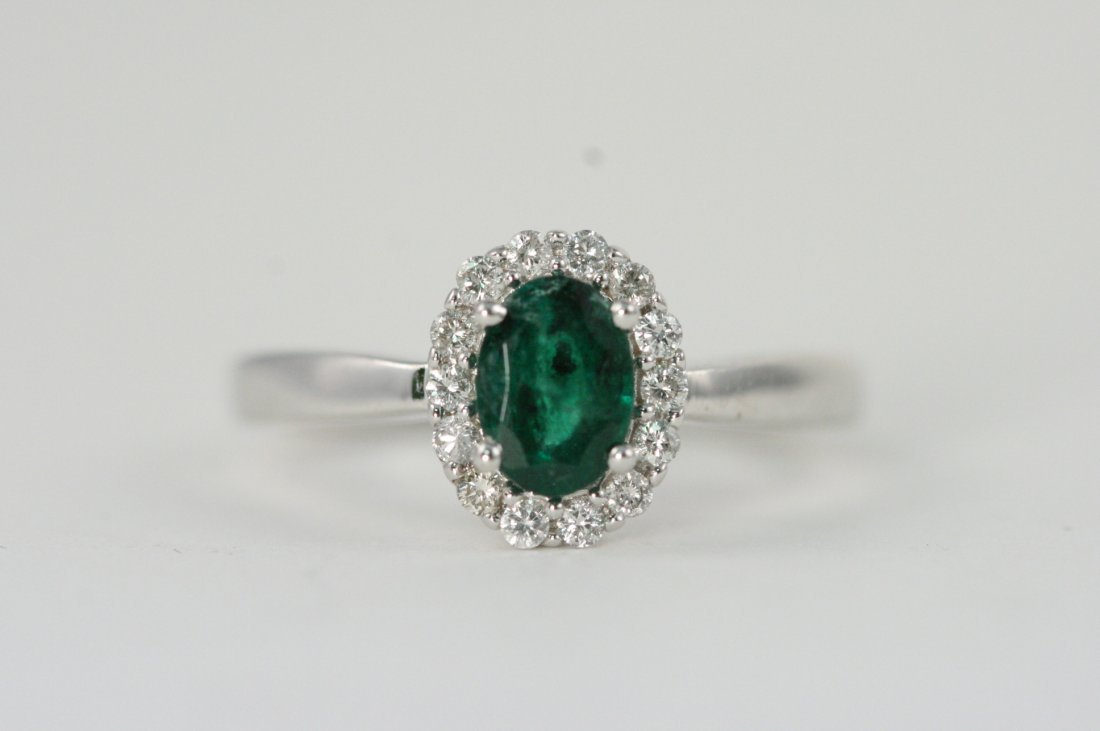 14K W/G RING WITH A BEAUTIFUL EMERALD AND DIAMONDS