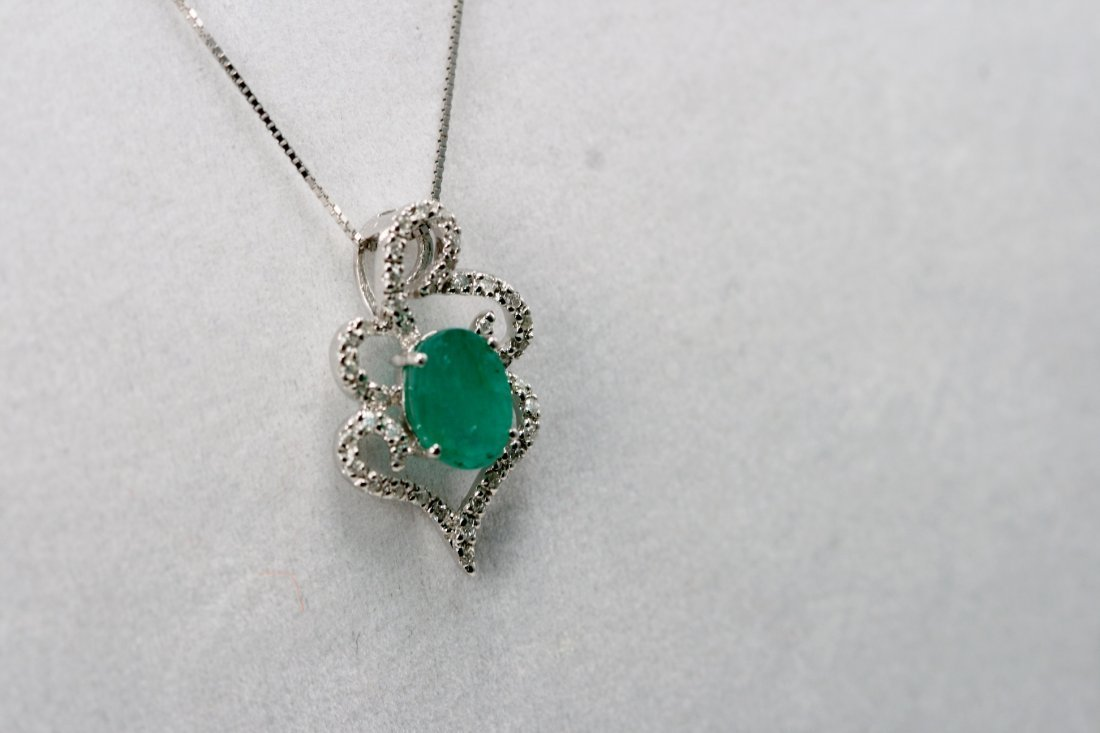 14K W/G NECKLACE SET WITH DIAMONDS AND OVAL CUT EMERALD