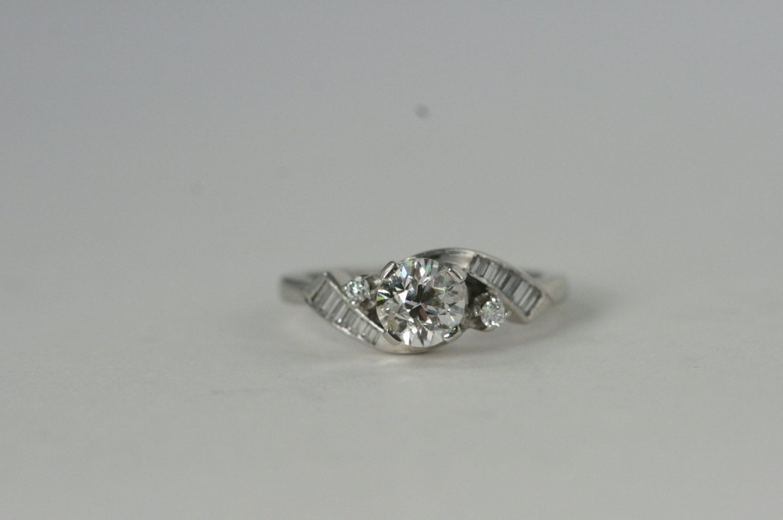 PLATINUM RING WITH .90 TW AND .35CT DIAMONDS