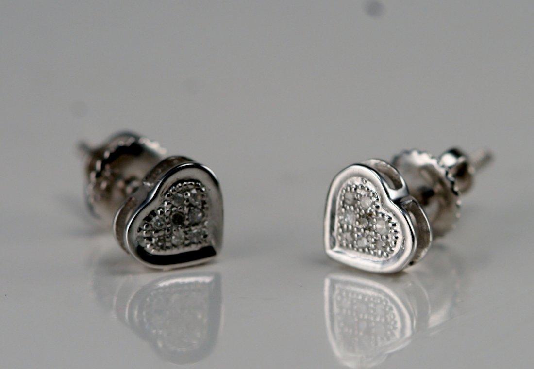 14K W/G HEART SHAPE DIAMOND EARRINGS.