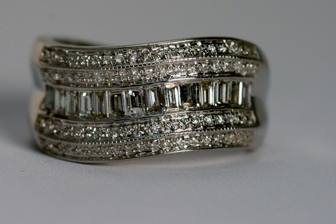 14K W/G CHANNEL SET DIAMOND RING.
