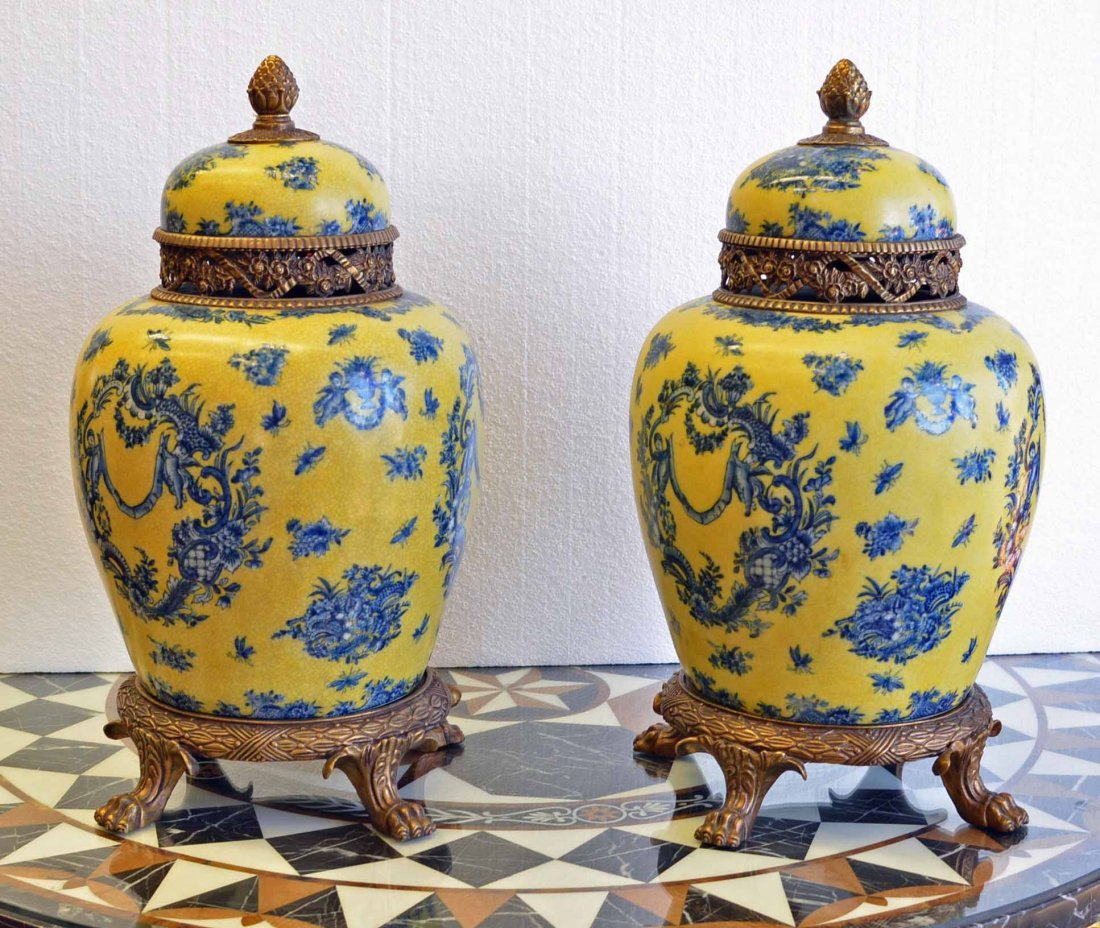 PAIR OF PORCELAIN ORIENTAL URNS ON BRONZE STANDS