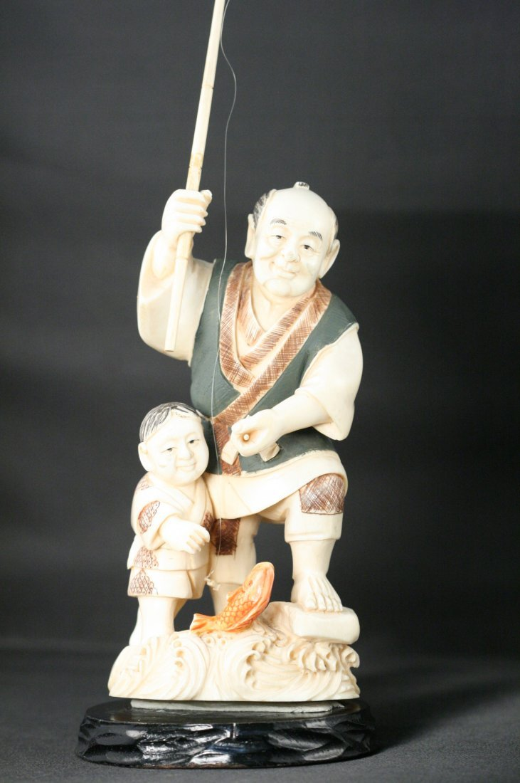 VINTAGE SOLID IVORY JAPANESE CARVING OF FISHERMAN