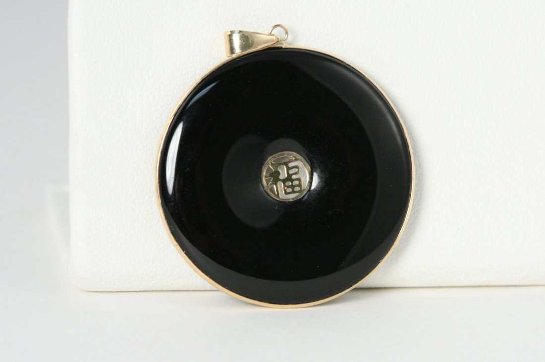 ONYX PENDANT WITH 14K Y/G ASIAN SYMBOL AND ACCENTS