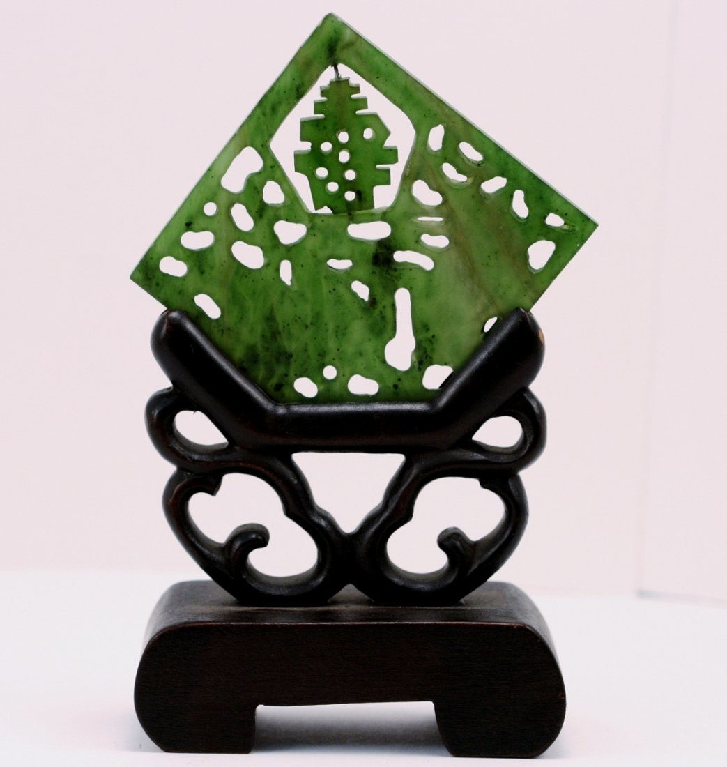 SMALL GREEN CARVED JADE PLAQUE WITH TEAKWOOD HOLDER
