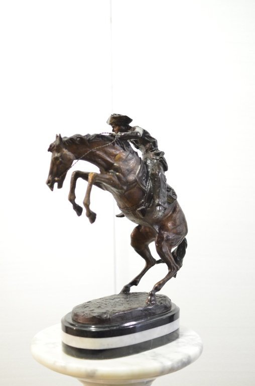 Bronze horse with man