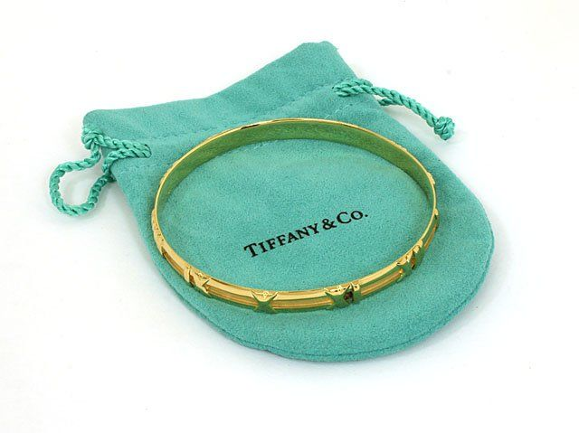 TIFFANY & CO. 18K GOLD ATLAS NUMERICAL LADIES BANGLE