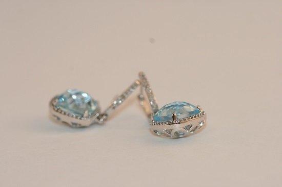 W/GOLD PAIR OF LADIES DIAMOND AND BLUE TOPAZ EARRINGS