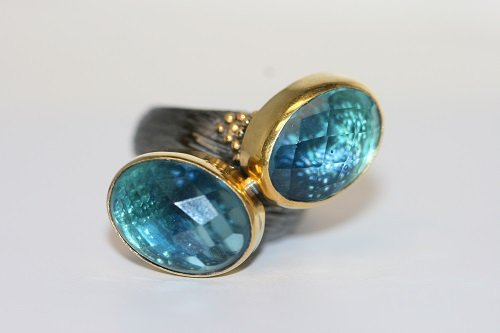 BLUE TOPAZ RING SET IN SILVER AND 22K GOLD OVERLAY