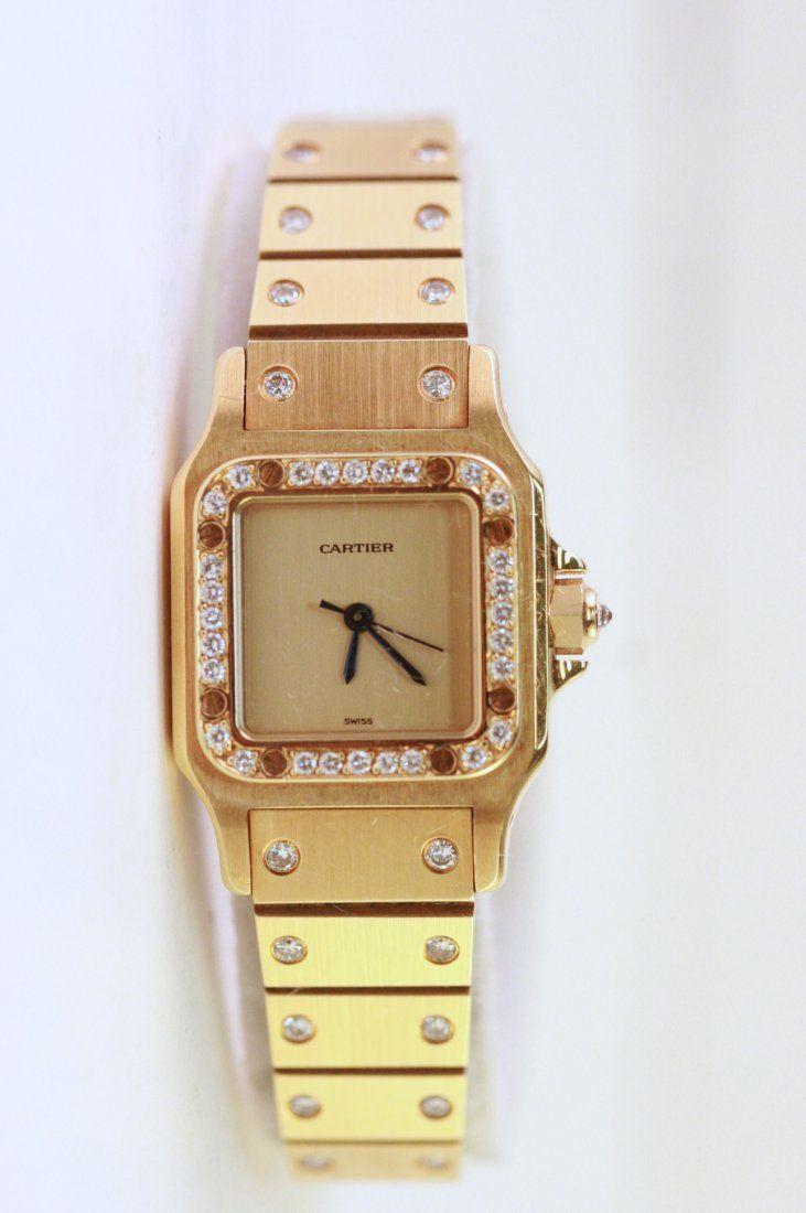Ladies 18k gold Cartier Watch