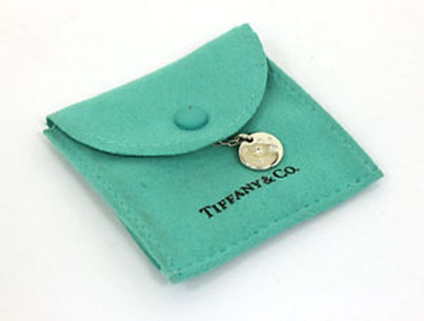 Tiffany & Co. 18k White Gold & Diamond Note Pendant &