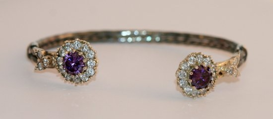 Gorgeous bangle set with a round and large pear shape a
