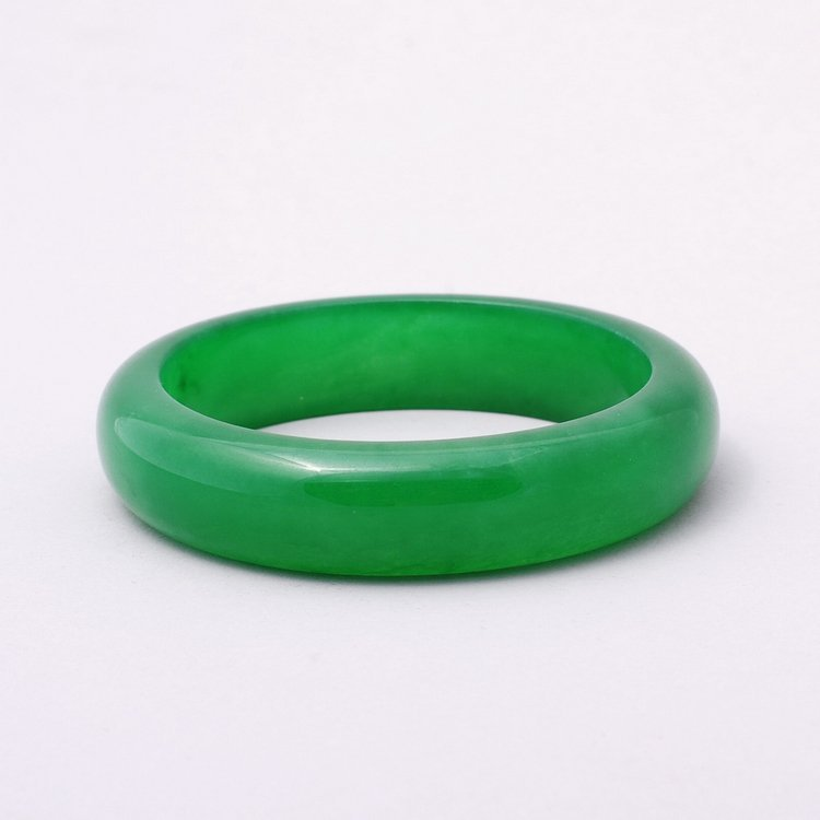4065: CHINESE CARVED JADE BRACELET