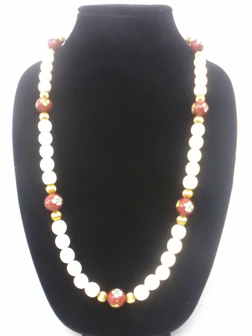 4293: Very long Asian ivory beaded necklace