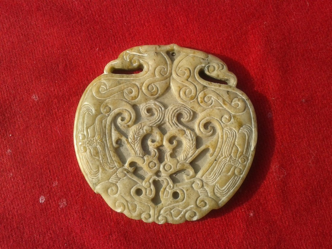 Carved pendant disc