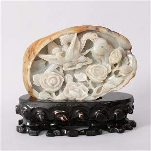 1086: A FINE CHINESE CARVED HETIAN JADE BOULDER