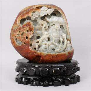 1123: A VERY FINE CHINESE CARVED HETIAN JADE BOULDER