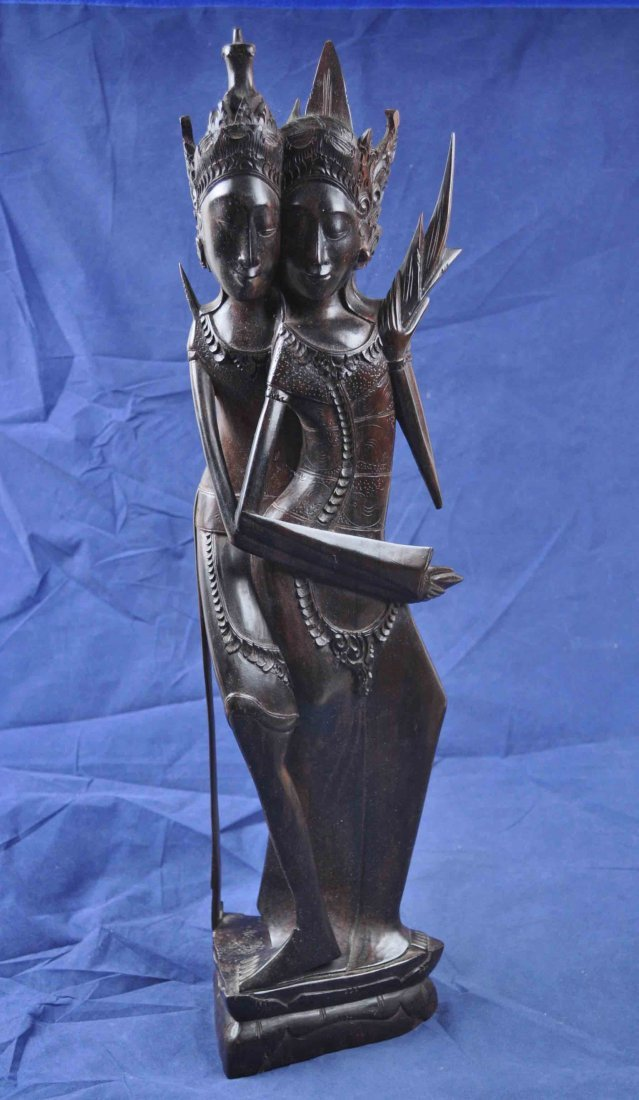 24:Carved Ross Wood Statue