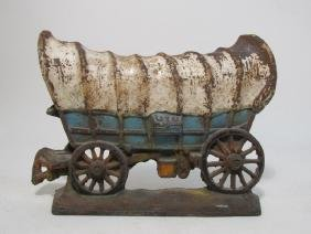 VINTAGE CAST IRON COVERED WAGON OXCART DOORSTOP