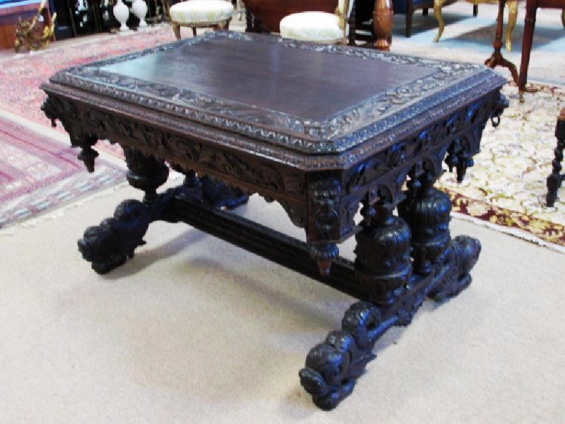 ANTIQUE CARVED OAK DESK, MANNER OF R.J. HORNER