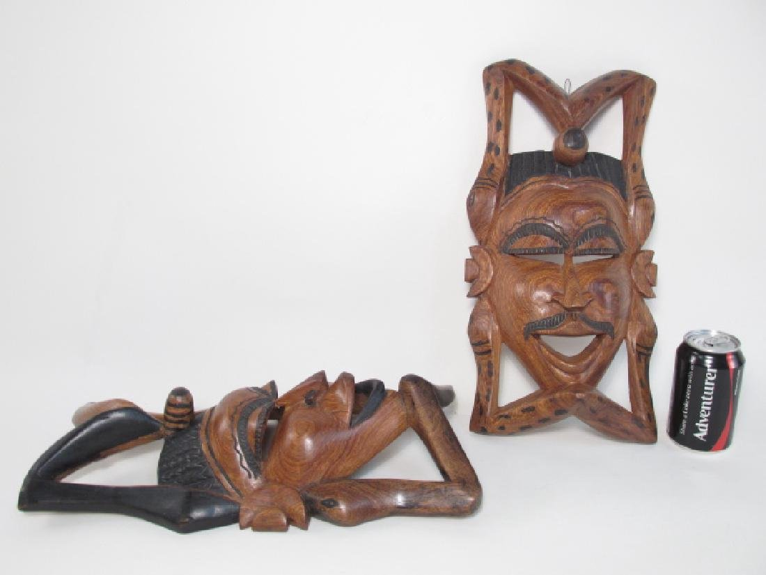 TWO TRIBAL STYLE CARVED WOOD MASKS - 10