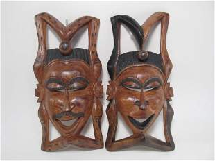 TWO TRIBAL STYLE CARVED WOOD MASKS