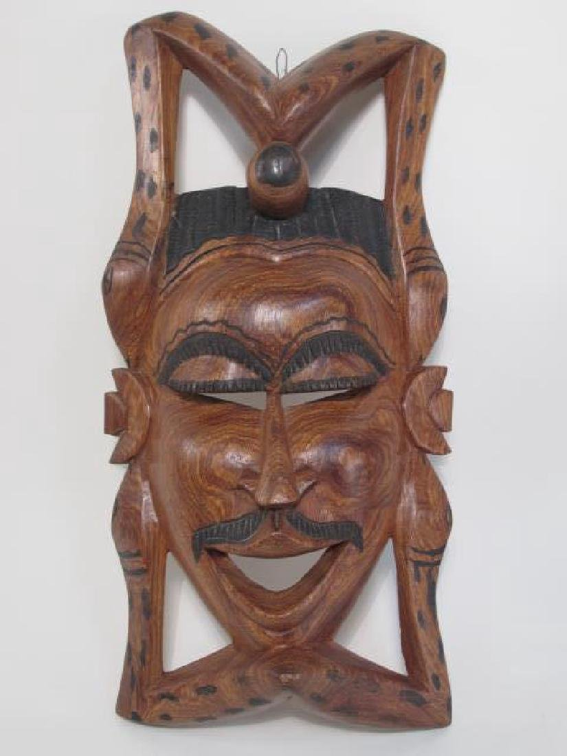 TWO TRIBAL STYLE CARVED WOOD MASKS - 2