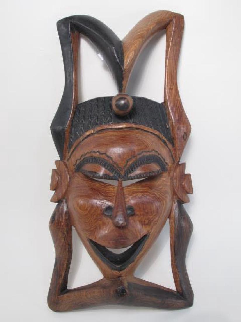 TWO TRIBAL STYLE CARVED WOOD MASKS - 6
