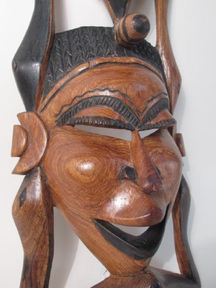 TWO TRIBAL STYLE CARVED WOOD MASKS - 7
