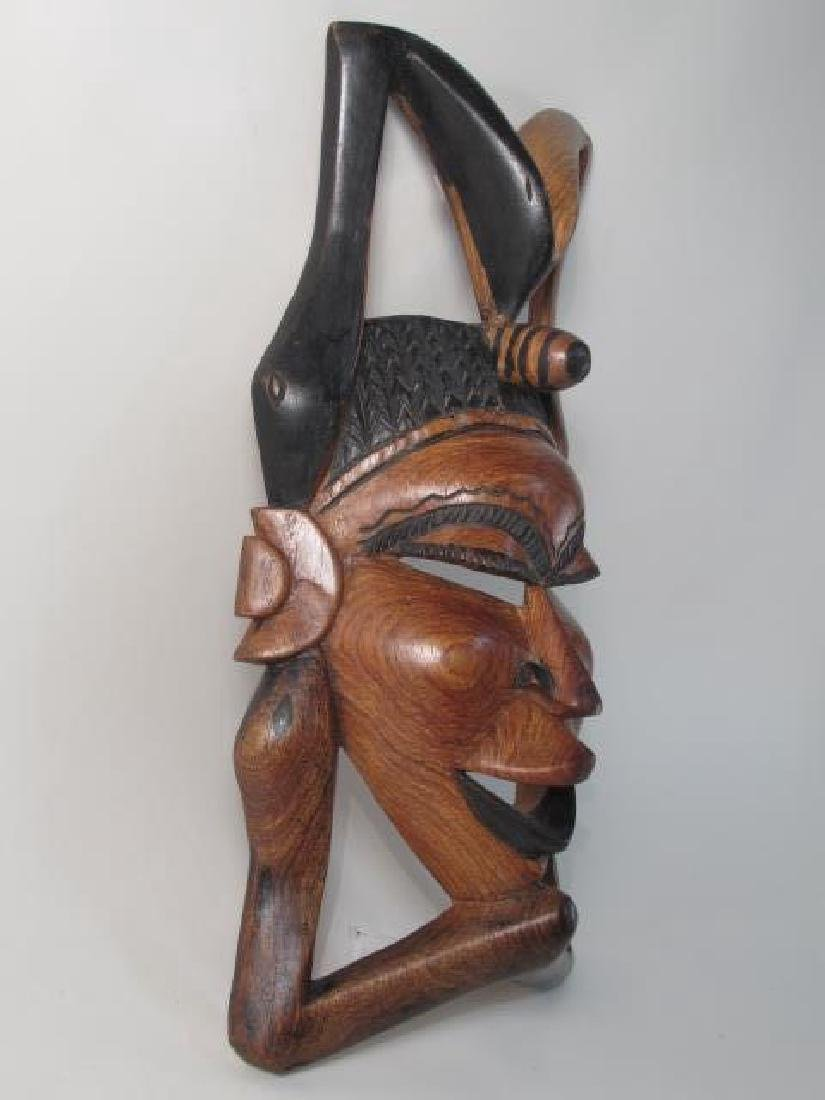 TWO TRIBAL STYLE CARVED WOOD MASKS - 8