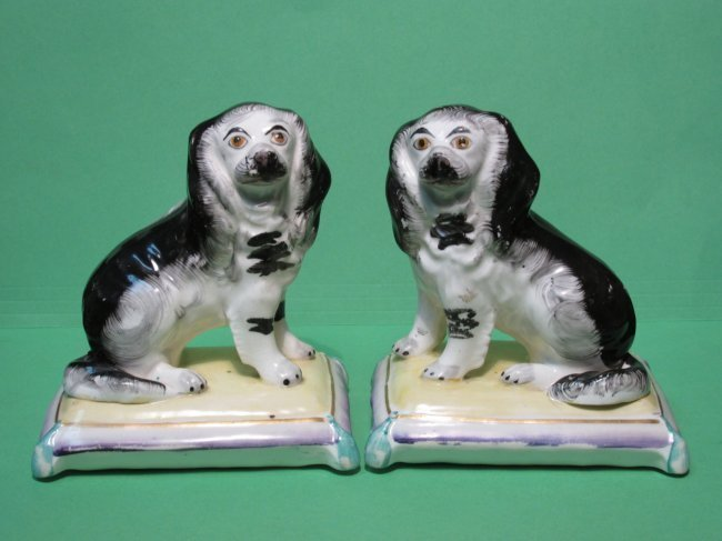 PAIR 19TH C STAFFORDSHIRE SPANIELS ON PILLOWS