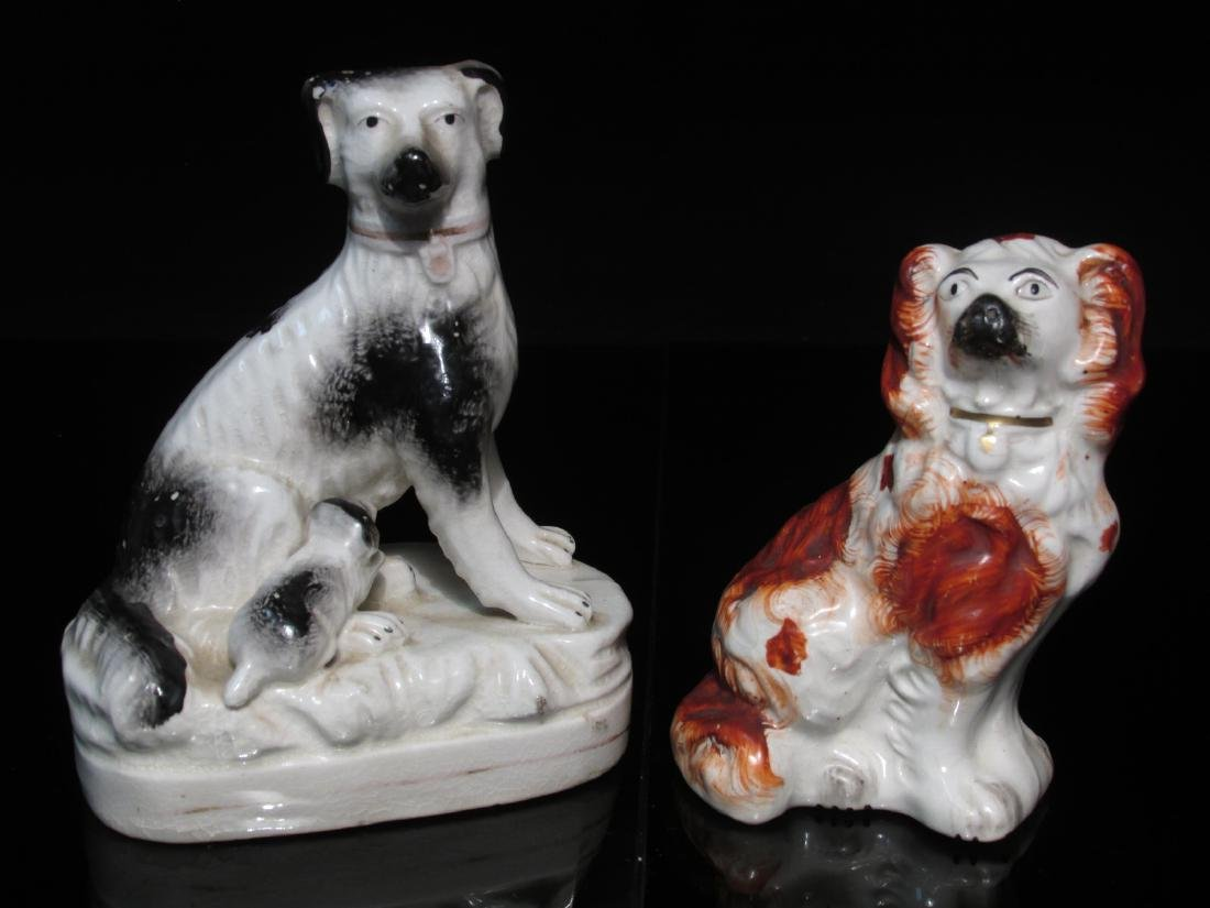 TWO STAFFORDSHIRE PORCELAIN FIGURINES: SPANIELS