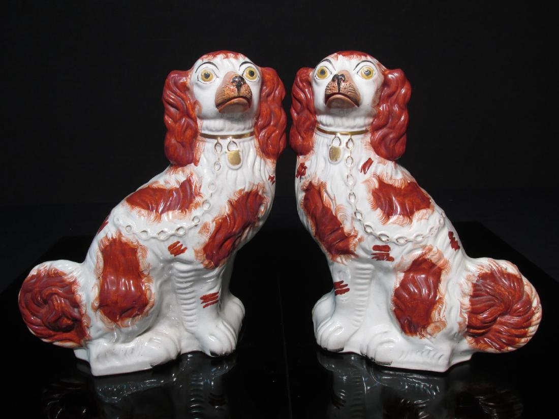 PAIR 19TH C STAFFORDSHIRE PORCELAIN SPANIELS