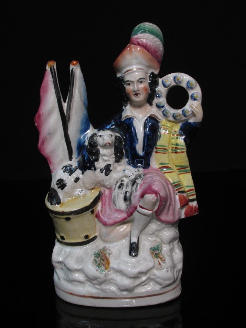 19TH C STAFFORDSHIRE FIGURINE MAN W/ DOG & DRUM