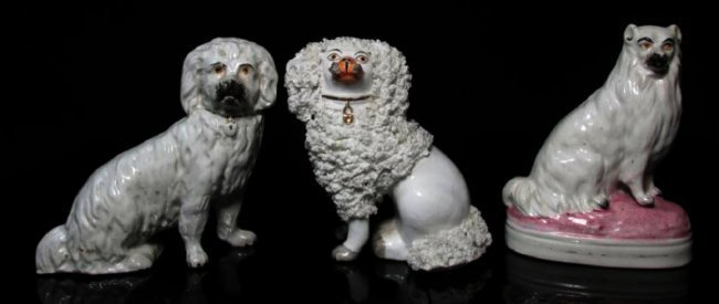 THREE 19TH C STAFFORDSHIRE PORCELAIN SEATED DOGS