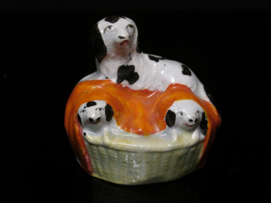 FOUR 19TH C STAFFORDSHIRE MINIATURES: DOG BOX ETC - 2