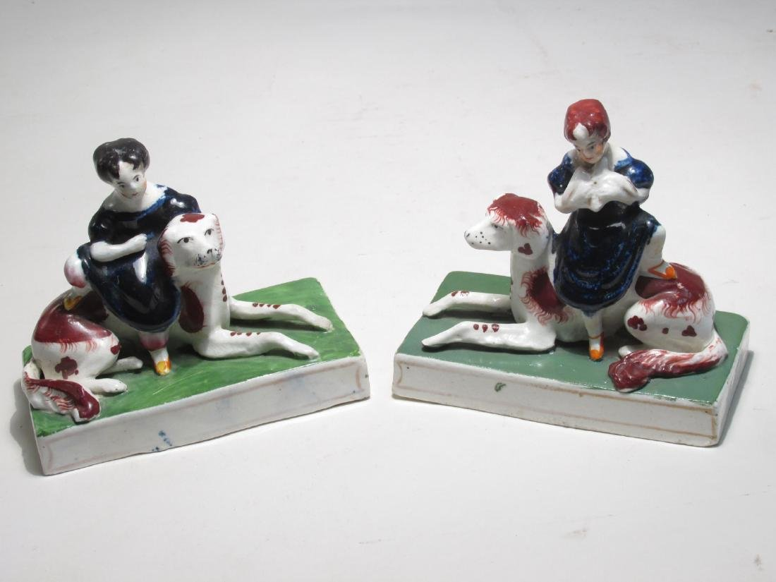 PAIR STAFFORDSHIRE FIGURES ROYAL CHILDREN W/ DOGS