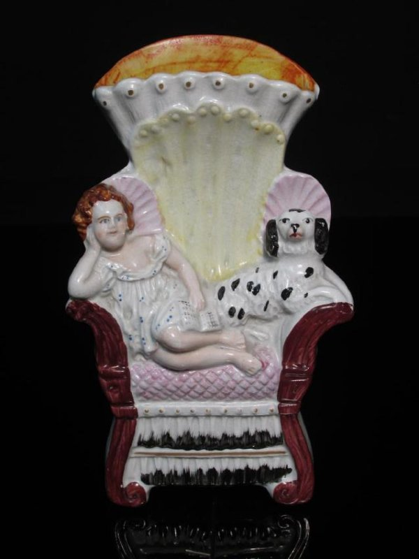 19TH C STAFFORDSHIRE GIRL & DOG SEATED IN CHAIR